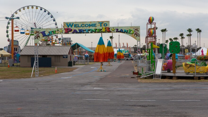 The Florida State fairgrounds begins its transformation from empty lots to bustling carnival rides and games.
