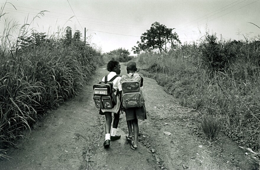 Schoolgirls walk home from school in a rural area in Southern Natal Province, South Africa.