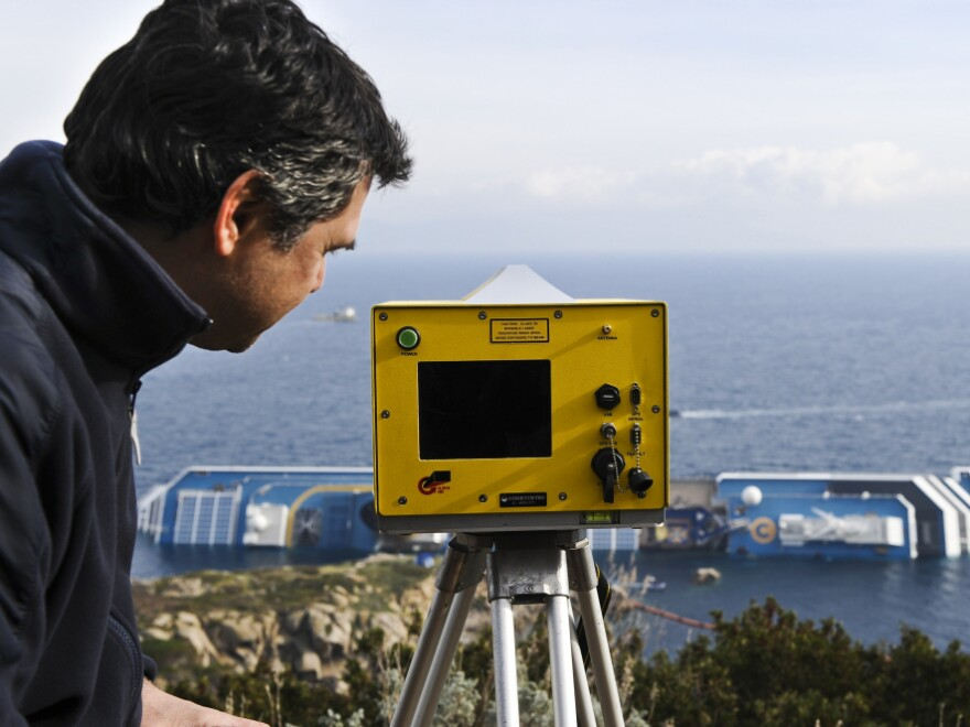 Technician Andera Faccioli positioned a laser-equipped device to determine whether the Costa Concordia has shifted position off the Tuscan island of Giglio, Italy.
