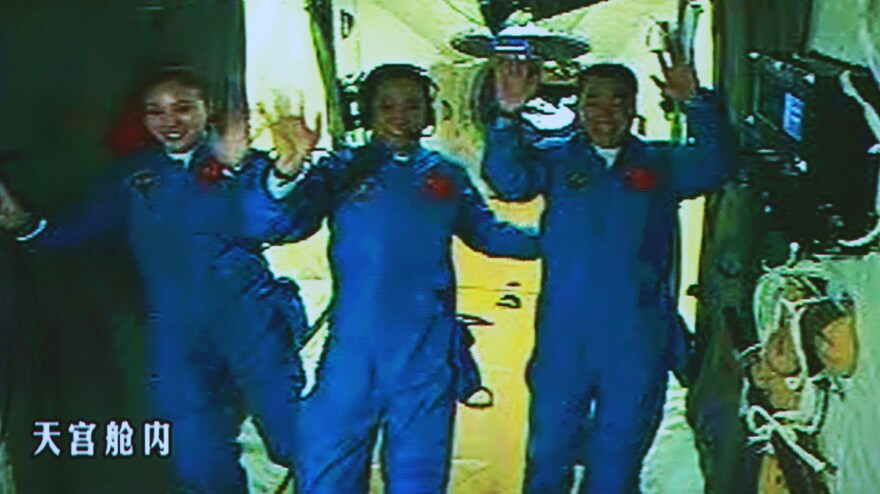 Nie Haisheng, Zhang Xiaoguang and Wang Yaping aboard the Tiangong-1 space module in June. China is leading what some see as a space race among Asian countries: It has worked on a lunar rover, a space station and an unmanned mission to Mars.