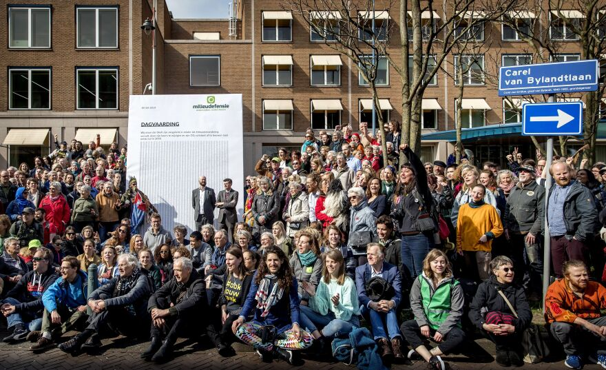 Dozens of activists marched to Shell's headquarters in The Hague, The Netherlands, in April 2019, where they delivered a legal summons to the company. The civil case began Tuesday, with plaintiffs demanding the company reduce its carbon dioxide emissions.