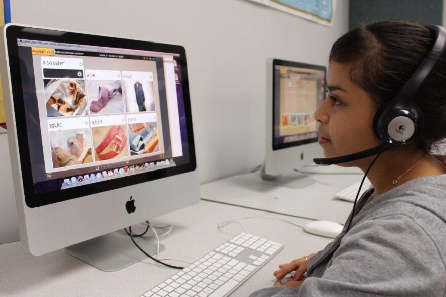 Latino students have a chance to work with bilingual technology as part of the Hispanic Outreach Program.