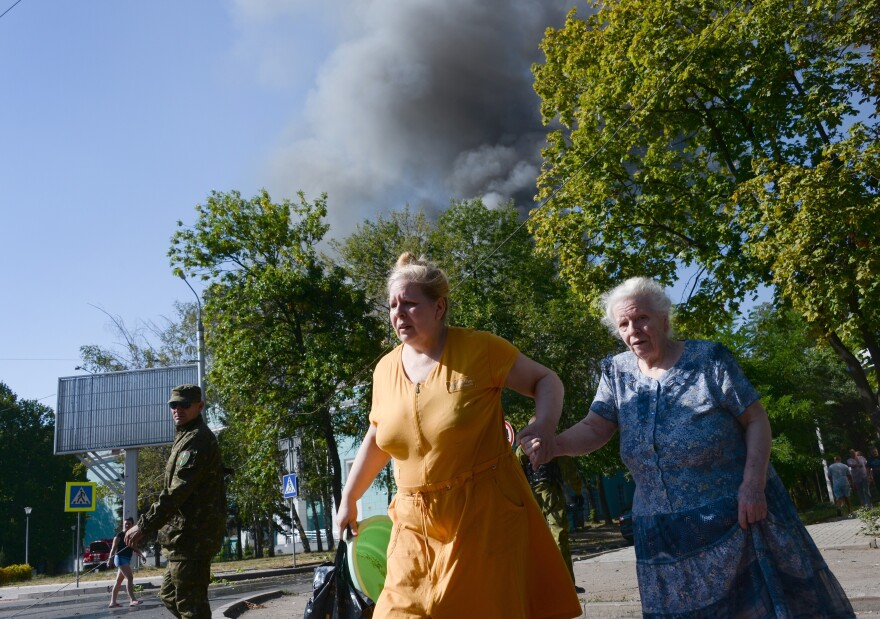 Women rush across the street after shelling in the town of Donetsk, Ukraine, on Wednesday.