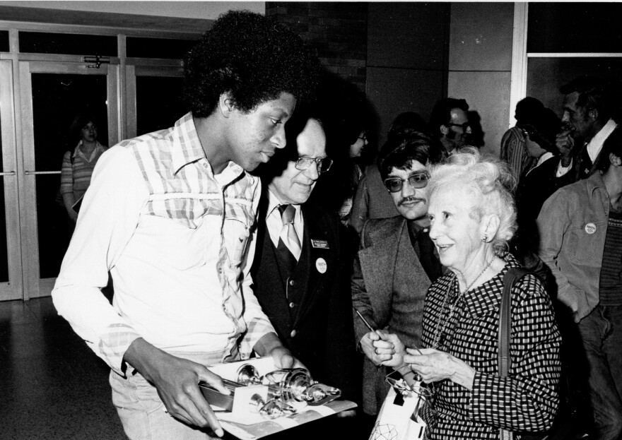 Jimmy Wilson chats with mathematician Nura Turner at the United States of America Mathematical Olympiad in 1978.