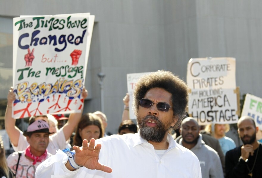 "<p>Princeton professor Cornel West was arrested when he spoke outside D.C. Superior Court on Oct. 17. But even as he was being led away in handcuffs, West told the crowd, ""We have no quarrel with the police. They are working people, part of the 99 percent, too.""</p>"