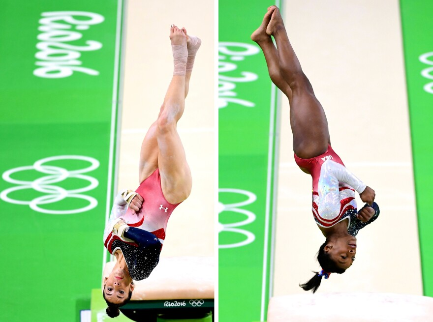 Aly Raisman (left) and Simone Biles (right) of the United States compete on the vault during the women's team final.