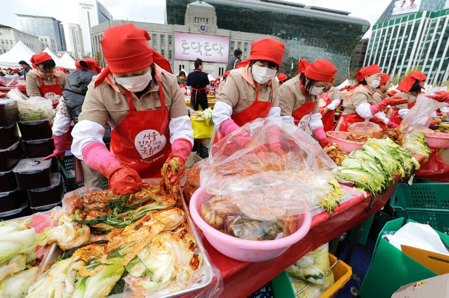 In 2014, about 2,300 people in Seoul made 250 tons of kimchi, a traditional fermented South Korean pungent vegetable dish, to donate to neighbors in preparation for winter.