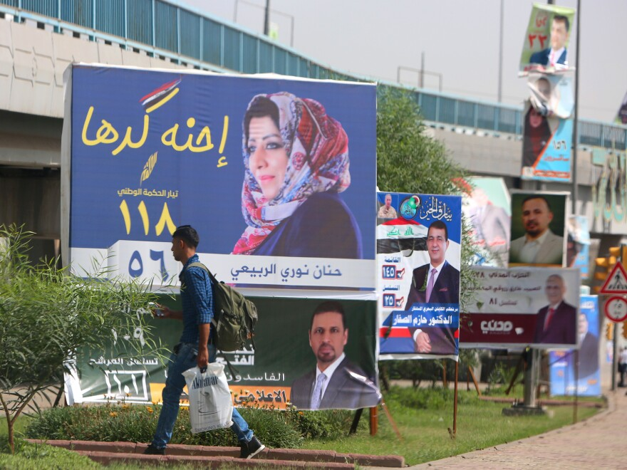 """We are up to it,"" says the slogan on parliamentary candidate Hanan Nouri al-Rubaye's billboard in Baghdad. Some 40 percent of candidates in Saturday's elections are women."