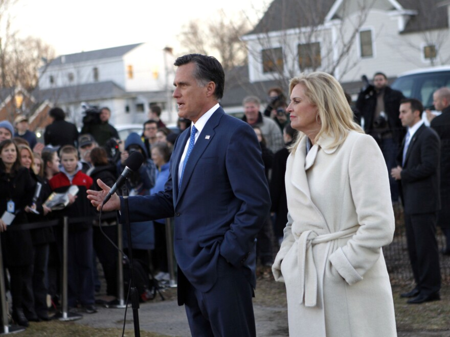 Mitt Romney, with wife Ann, talks to reporters after voting in the Massachusetts primary in Belmont, Mass, Tuesday, March 6, 2012.