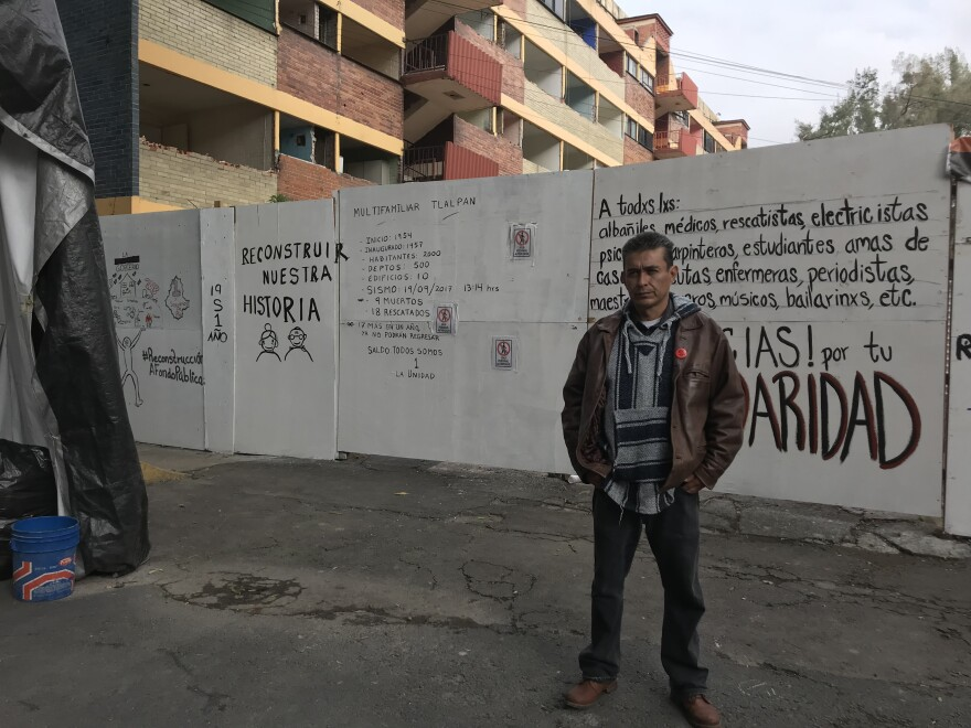 Angel Fuentes Martínez, 50, receives about $200 per month in government aid as an earthquake victim. But he says it's not enough to rent a new apartment, and he often spends it on health care since he frequently gets sick living in a tent next to the complex.