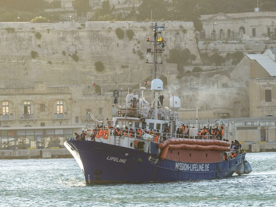The MV Lifeline, a vessel for the German charity Mission Lifeline, arrives with 234 migrants onboard in the harbour of Valletta, Malta, on Wednesday.