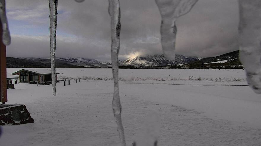 Parts of Montana were hit with more than 2 feet of snow over the weekend, the National Weather Service says. Here, a Glacier National Park webcam shows the sun trying to reach the peaks at the St. Mary Visitor Center, near the Blackfeet Reservation.