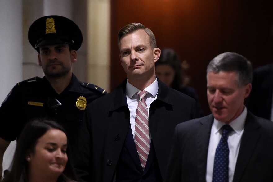 David Holmes, a State Department official, arrives to a closed-door deposition in the House impeachment inquiry.