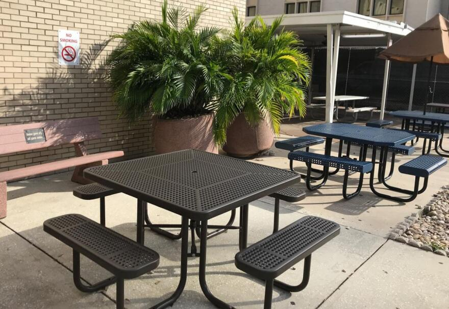 "Formerly a designated smoking area, this patio outside the VA hospital in Tampa now is posted with ""No Smoking"" signs"
