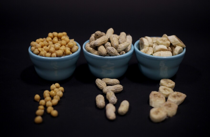 Chickpeas, peanuts and bananas are among the ingredients that scientists use in a paste to help rehabilitate gut microbes in severely malnourished children.