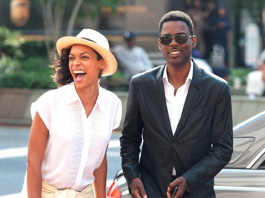 Rosario Dawson (left) plays Chelsea Brown, a <em>New York Times</em> reporter who spends a day interviewing Rock's character, Andre Allen.