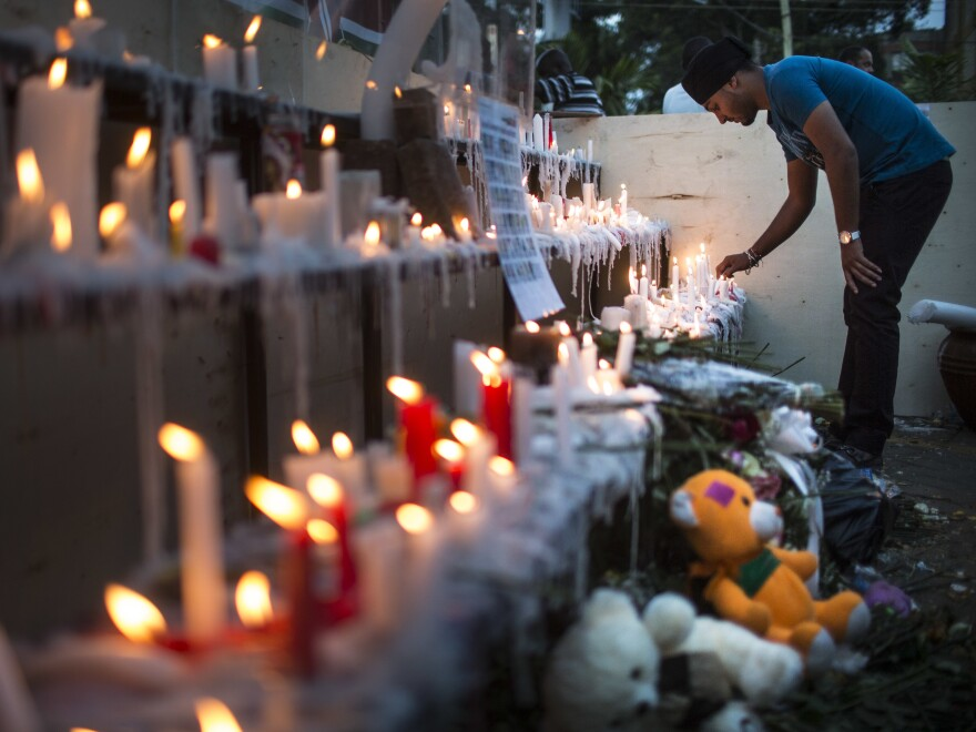 People light candles for the victims of the attack outside the Westgate Shopping Centre on September 29, 2013 in Nairobi, Kenya. Two men were found guilty Wednesday for aiding the attack.