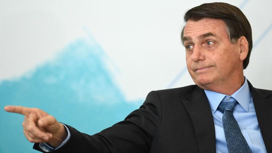 Brazilian President Jair Bolsonaro attends an International Youth Day celebration in Brasília last week. Deforestation in the Amazon has soared since the far-right leader took office in January.
