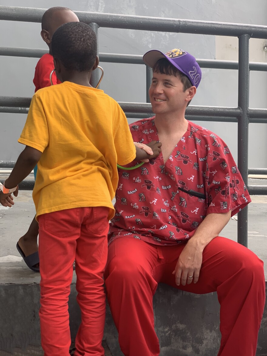 Dr. Andrew Myers spent time with the displaced children in Nassau in between school physicals. USF HEALTH