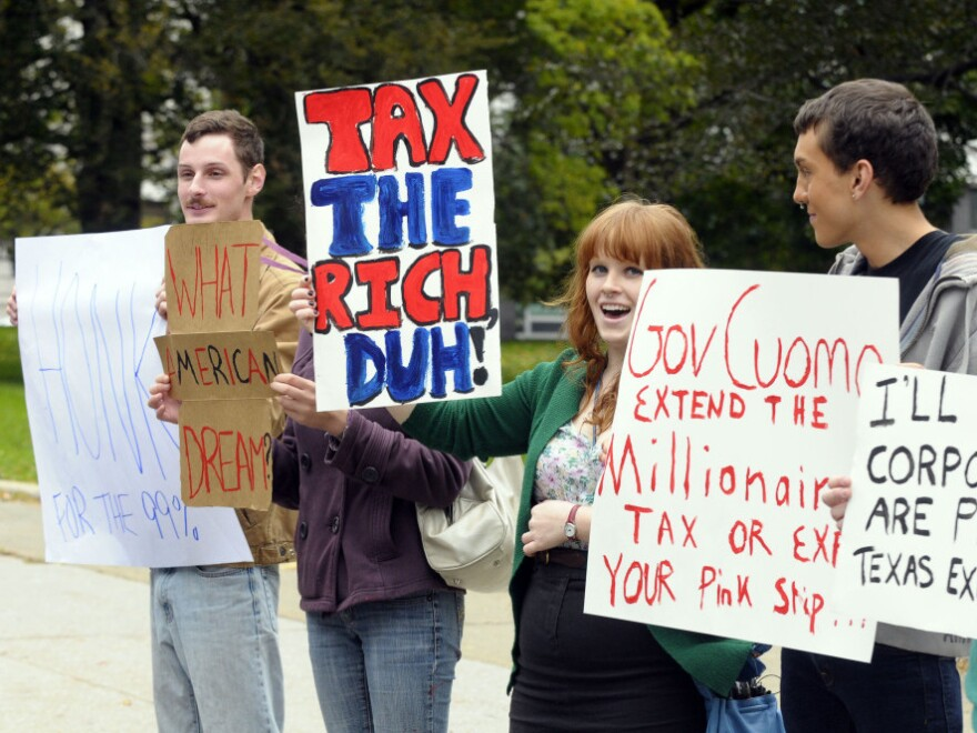 <p>Demonstrators supporting the Occupy Wall Street movement — and an extension of the millionaires tax in New York — protest in Albany on Oct. 21.</p>
