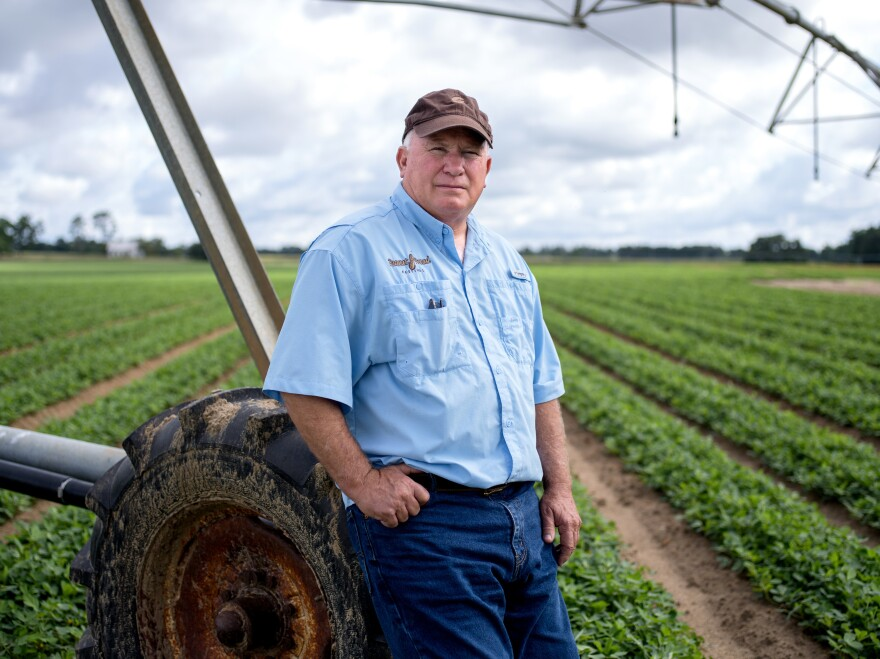 Mike Newberry stands next to the center pivot irrigation system that waters his peanut crop. A fourth-generation farmer, he is the last in his family to farm. His only child, a daughter, has a career as a physical therapist.