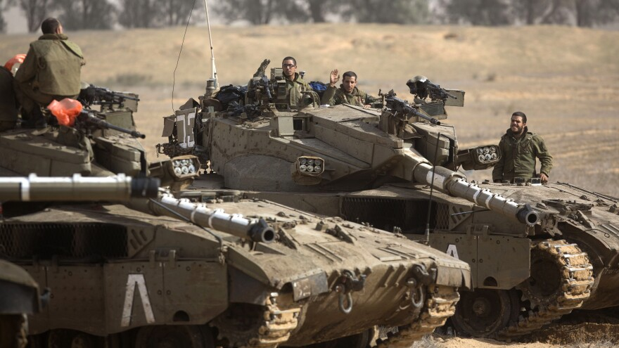 Israeli tanks on the border with the Gaza Strip earlier today. Israeli officials have said they are prepared to mount a ground offensive.