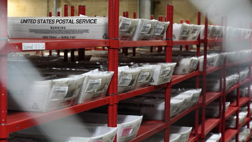 The U.S. Postal Service says it has processed and delivered 122 million mail-in ballots.