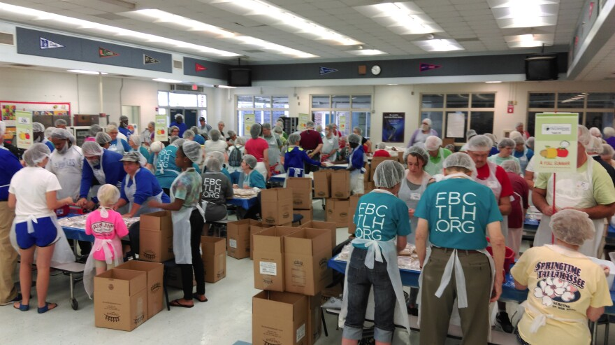Hundreds of enthusiastic volunteers packed thousands of meals during the Full Summer event at Godby High School.