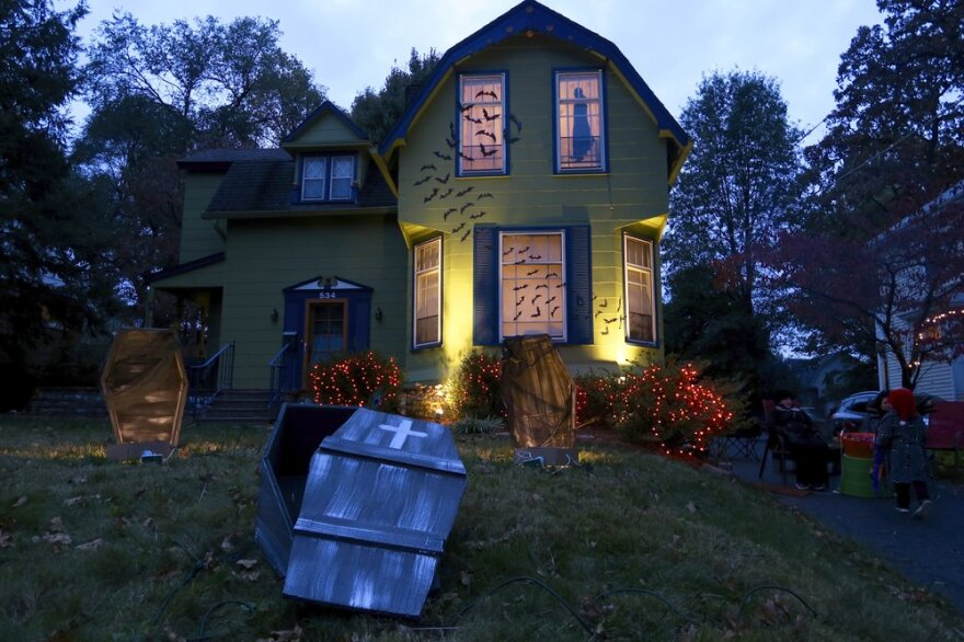 A home decorated for Halloween with bats and coffins.