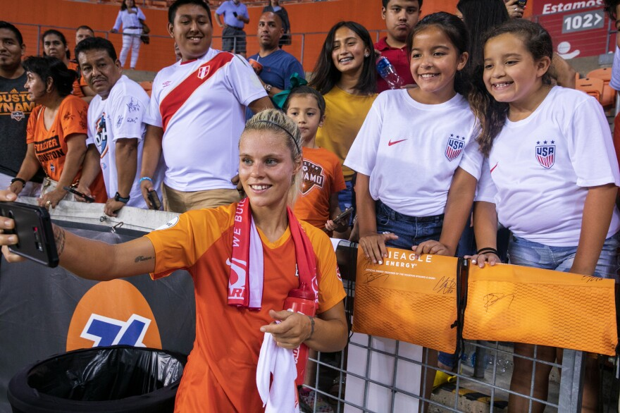 Houston Dash team member and member of England's World Cup team Rachel Daly takes a selfie with fans after the game.