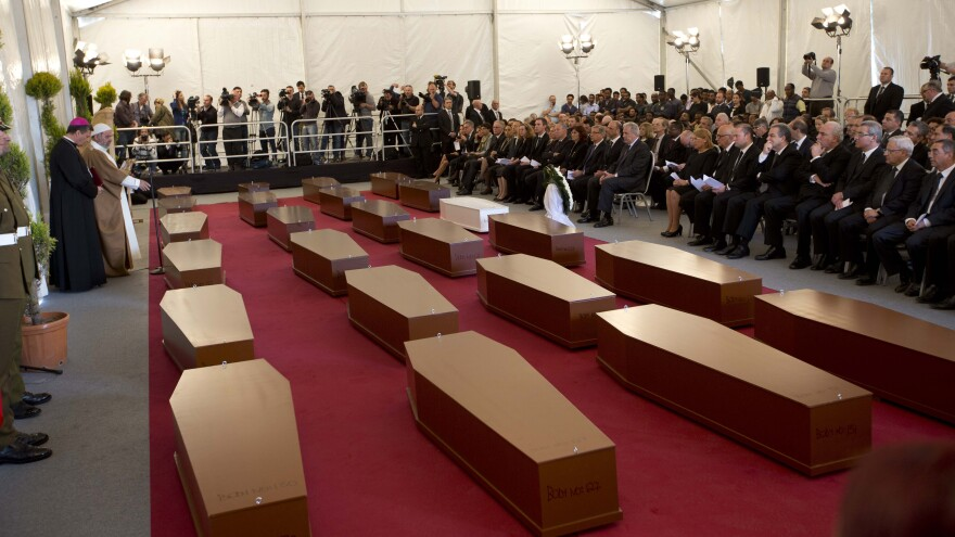A funeral service for 24 migrants who drowned while trying to reach the southern coasts of Italy, in April. The migrants died as a smuggler's boat crammed with hundreds of people overturned off the coast of Libya.