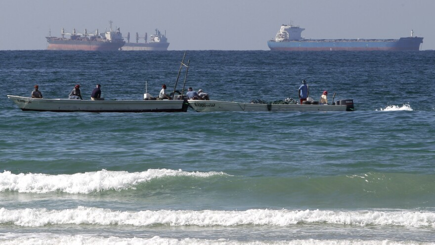 European countries have agreed to stop importing Iranian oil as of Sunday. This could make it harder for Iran to find markets for its crude. Iran has been filling up tankers off its coast, but analysts say it could run out of storage capacity. This photo shows oil tankers off Iran's coast in January.