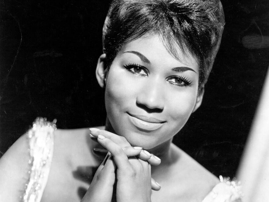 Soul singer Aretha Franklin poses for a portrait in 1964.