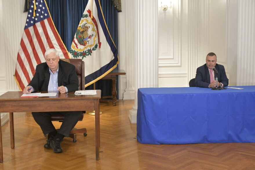 Gov. Jim Justice and his general counsel, Brian Abraham, give an update to the public regarding West Virginia's continued response to the coronavirus on Tuesday, May 19, 2020.