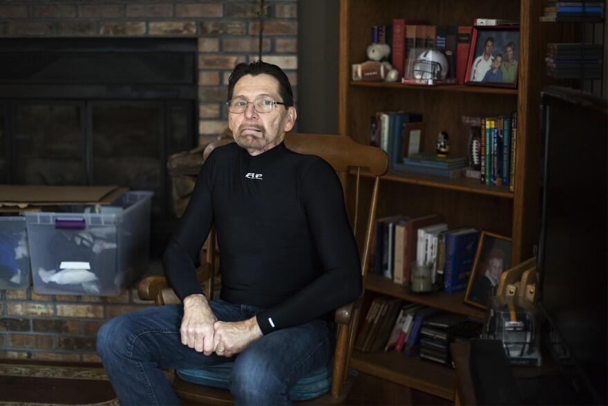 Cancer survivor Jim Nace poses in his Ballwin home.