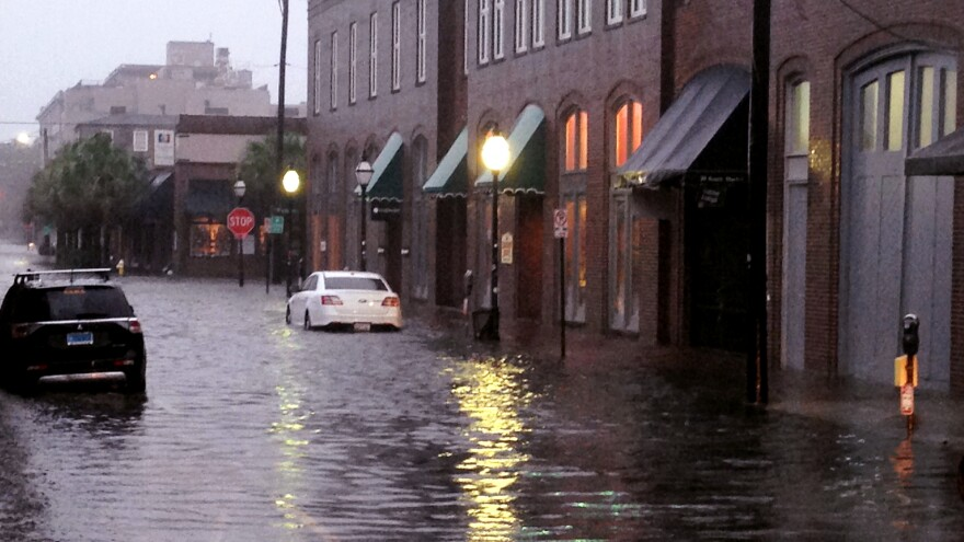 Flood waters rose near Charleston, S.C.'s popular City Market Saturday, as Hurricane Matthew neared. The storm could bring flash floods and a surge of between six and nine feet, forecasters say.