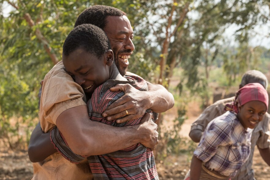 <em></em>In <em>The Boy Who Harnessed the Wind</em>, Chiwetel Ejiofor (left) plays Trywell, the father of titular teenager William Kamkwamba (played by Maxwell Simba). Ejiofor also directed the movie and wrote the screenplay.