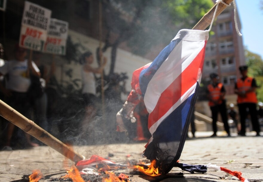 Argentine activists burn a Union Jack during a January protest in front of the British Embassy in Buenos Aires.