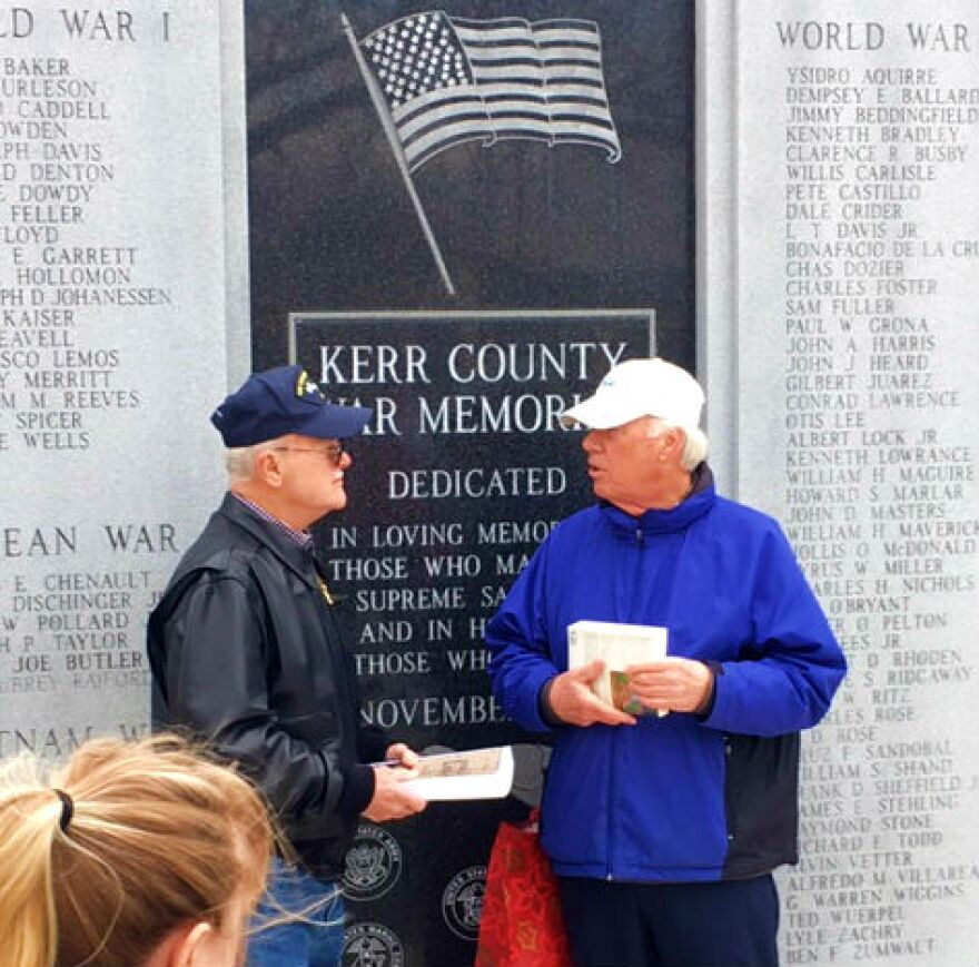 Wayne Gotke, on left, accepts his father's lost ring at a ceremony at the Kerry County War Memorial. Dec. 14