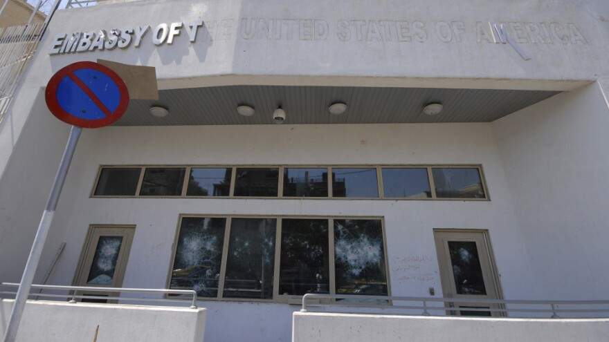 The damaged front side of the U.S. embassy is seen after pro-government protesters attacked the embassy compound in Damascus, Syria.