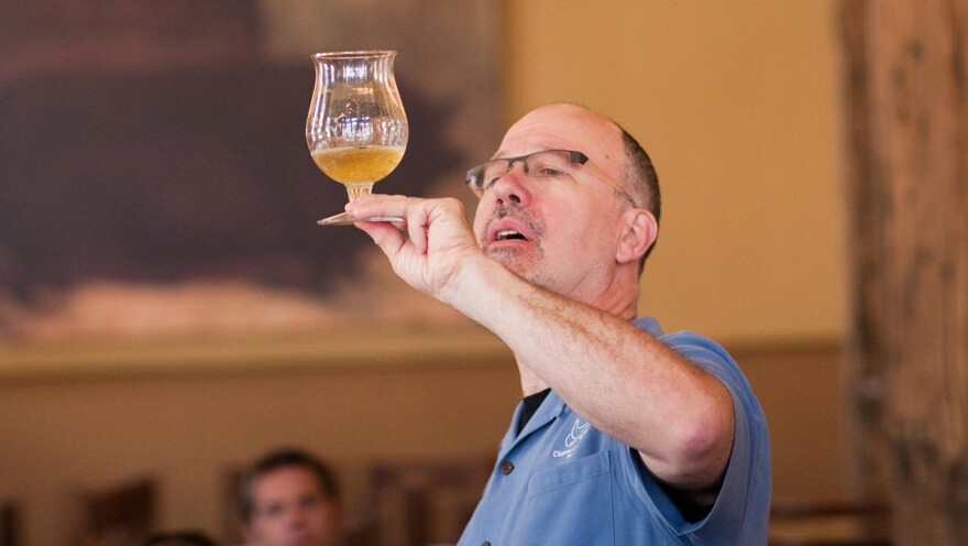 Ray Daniels inspects a glass of beer. A Chicago brewer, Daniels started the Cicerone training program five years ago.