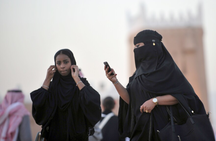 Saudi women, shown here at a cultural festival near the capital Riyadh on Sunday, still need the permission of male relatives to travel and even receive certain medical procedures, but a growing number are entering the workforce.
