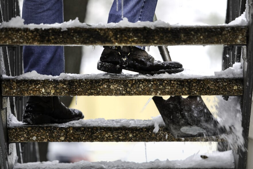 a man shoveling icy steps