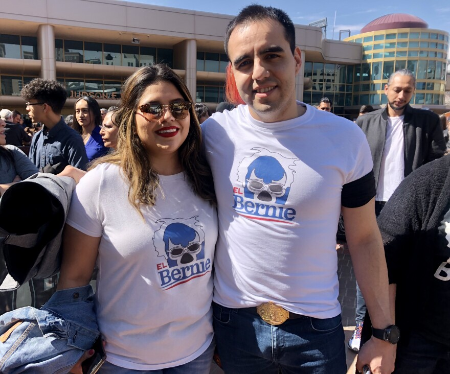 "Chris Hinojos and Dairen Sanchez wear T-shirts that depict Sanders as a lucha libre wrestler named ""El Bernie,"" at his rally in El Paso on Saturday."