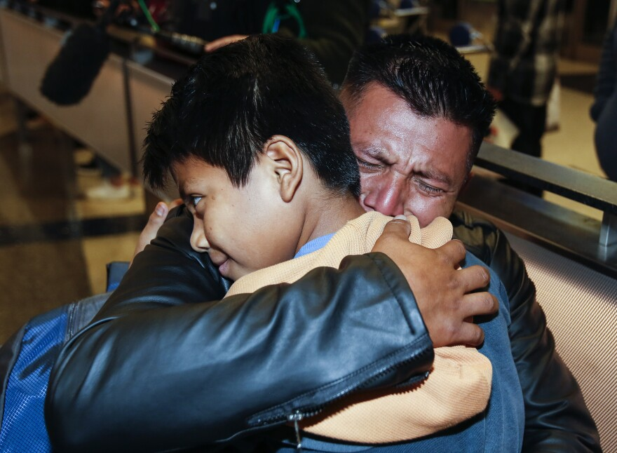 David Xol-Cholom of Guatemala hugs his son Byron at Los Angeles International Airport as they reunite after being separated about a year and a half ago during the Trump administration's wide-scale separation of immigrant families.