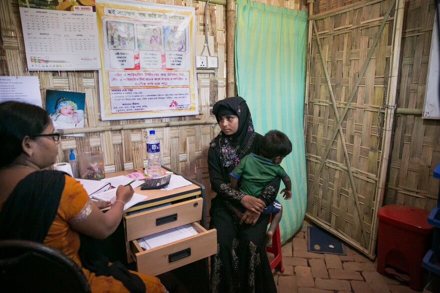 Sanura Begum at a Doctors Without Borders clinic with her son, Abdur Sobor, near the Kutupalong refugee camp. Before coming to Bangladesh, she says she'd never seen a doctor.