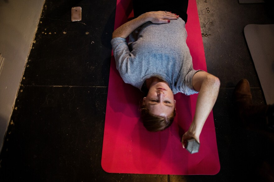 "Vanessa Wauchope begins abdominal exercises in Leah Keller's class in San Francisco, Calif. Keller teaches an exercise, called ""drawing in,"" to help strengthen abdominal muscles that tend to spread apart a bit during pregnancy."