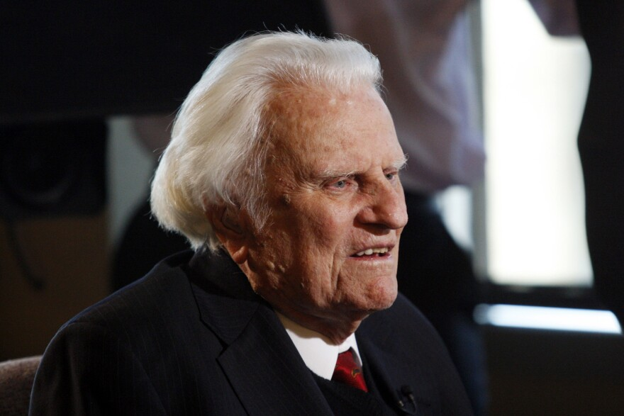 In this Dec. 20, 2010 file photo, evangelist Billy Graham speaks during an interview at the Billy Graham Evangelistic Association headquarters in Charlotte, N.C. (AP Photo/Nell Redmond, File)
