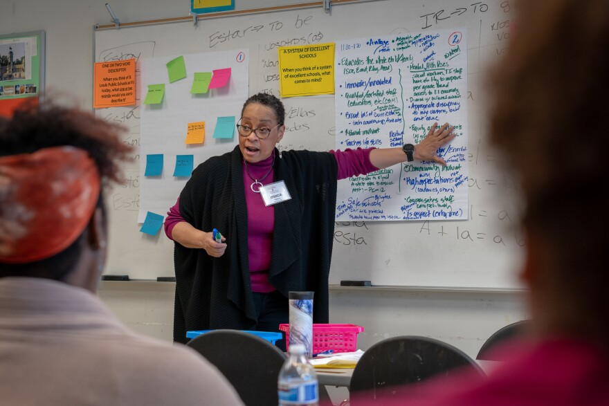 Jessica Perkins, a facilitator with Emerging Wisdom consultants, runs a discussion during St. Louis Public Schools' first community visioning session at Clyde C. Miller Career Academy Saturday, Feb. 29, 2020.