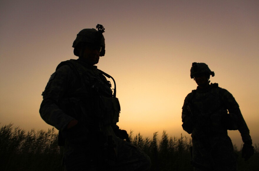 U.S. Army soldiers from D Co., 1st Battalion, 18th Infantry Regiment patrol outside Contingency Operating Site Taji, north of Baghdad, Iraq, Sunday, Aug. 7, 2011.